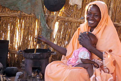Mariam Hammed cooking in her home in El Fasher, North Darfur.