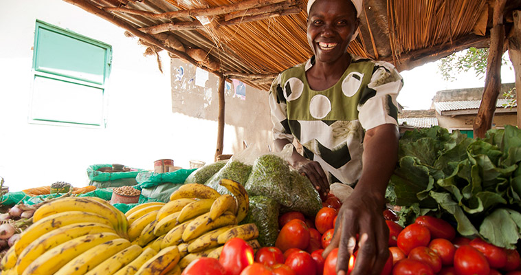 Mary started growing tomatoes in 2010 and now operates her own stand at her local market in Homa Bay County.