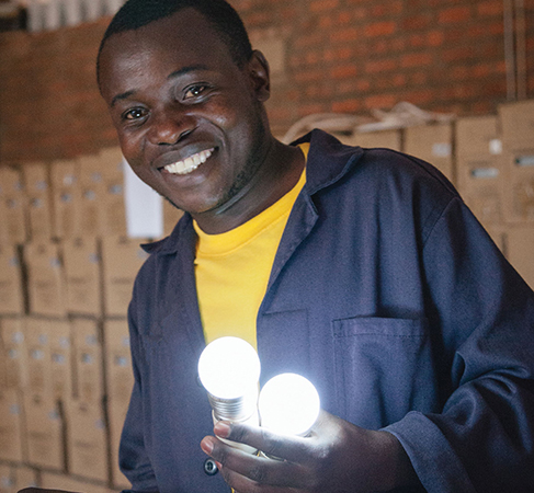 A man holds shining lightbulbs.