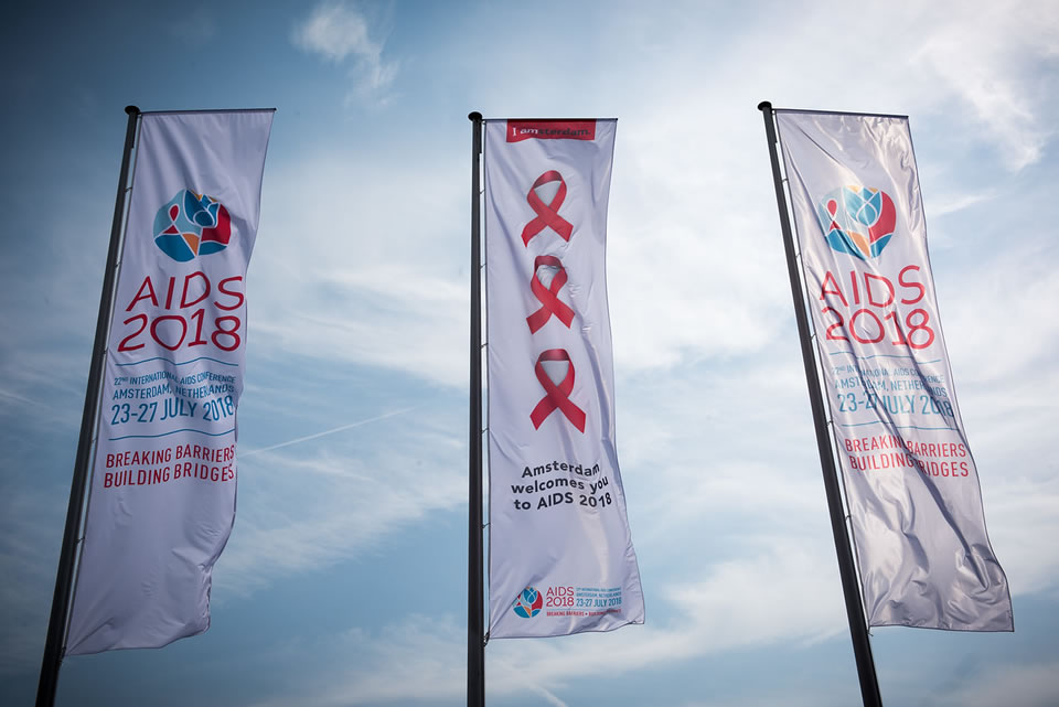 3 flags from the 22nd AIDS Conference.