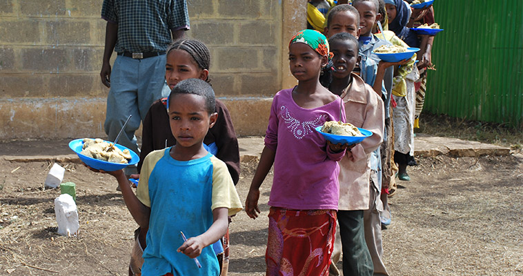 Children carry school lunches provided by the World Food Program in Ethiopia.