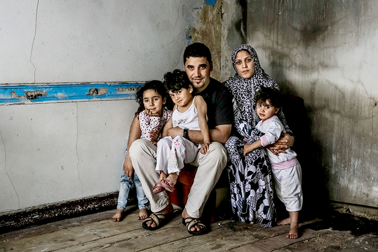 A family awaits humanitarian assistance