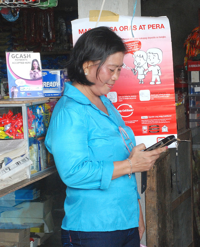 Mobile Banking Program Saves Filipinos Time and Money. Credit: USAID