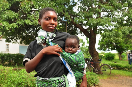 New mom Maria Mandira is just one of the women who benefitted from Saving Mothers, Giving Life's efforts in Zambia. Photo credit: Amy Fowler/USAID