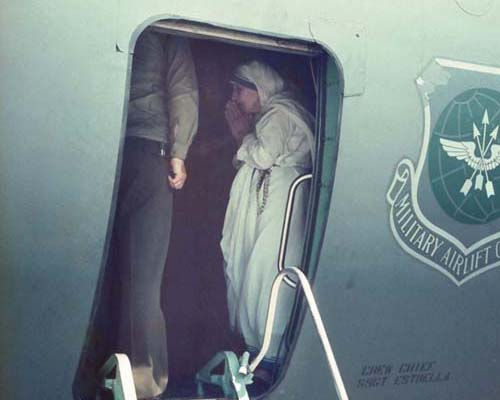 Mother Teresa on a U.S. military plane blessing the first shipment of food aid to Albania.