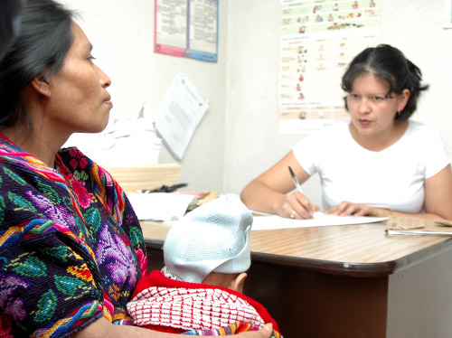 A woman discusses options with a family planning counselor at a Ministry of Health facility in Chichicastenango, Quiché.