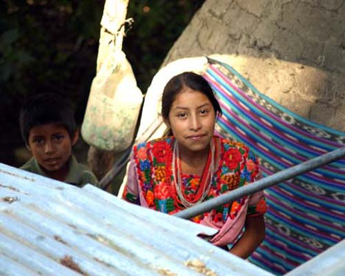 A brother and sister by the family adobe oven in a rural highlands village in Quiché, Guatemala, where the USAID/Save the Childr