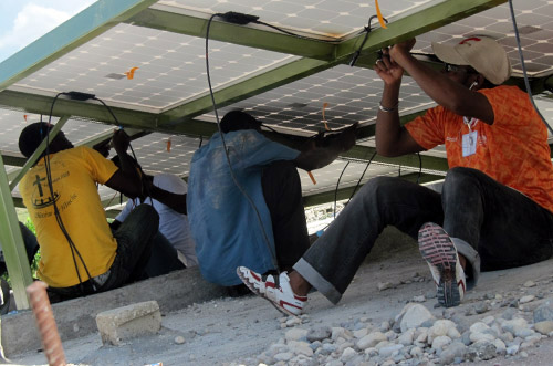 Technicians wire up solar panels as part of a hands-on training in Boucan Carré, Haiti.
