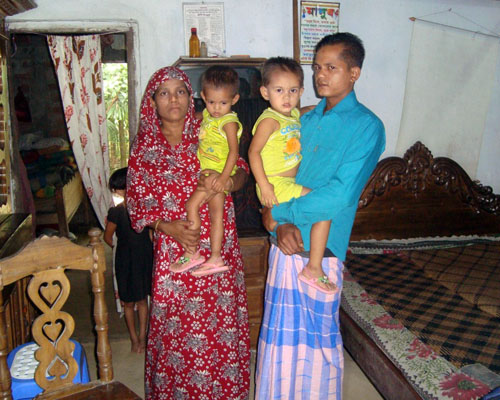 Laily Begum, left, pictured here with her husband and two young daughters, is one of 5,000 women in Bangladesh who have particip
