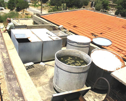 Water tank at Ehmej Intermediate School improperly covered and made of inappropriate material.