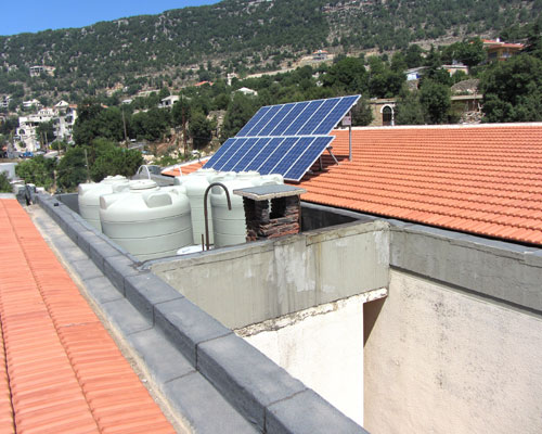 New water tanks at Ehmej Intermediate School installed by USAID. The solar panels for heating water were provided by the U.N. De