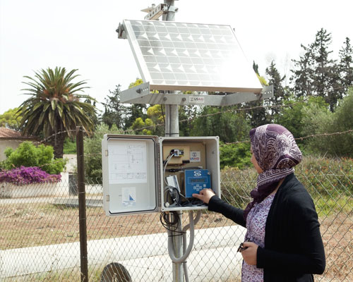 A technician from the Ministry of Agriculture tests a weather station installed by USAID in the Moulouya irrigated perimeter in