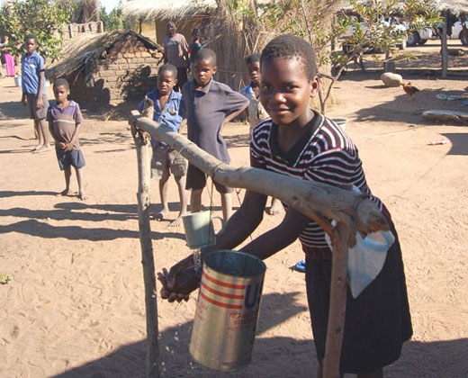 In Balaka, the chief's daughter, Flossie Kahinduka, demonstrates a simple hand-washing technique that is making the incidence of