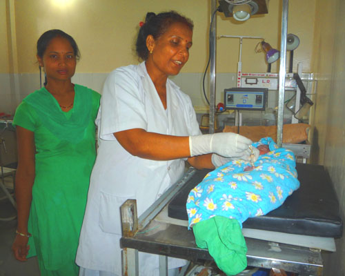 Application of chlorhexidine to the cord of a newborn baby in Banke district.