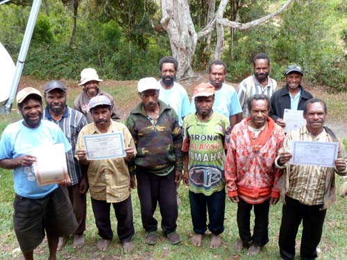 Volunteer teachers from Yahukimo District, Papua, proudly hold up their non-formal teaching certificates.