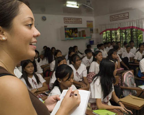 Peace Corps volunteer Mary Oyen teaches her students in the Philippines.