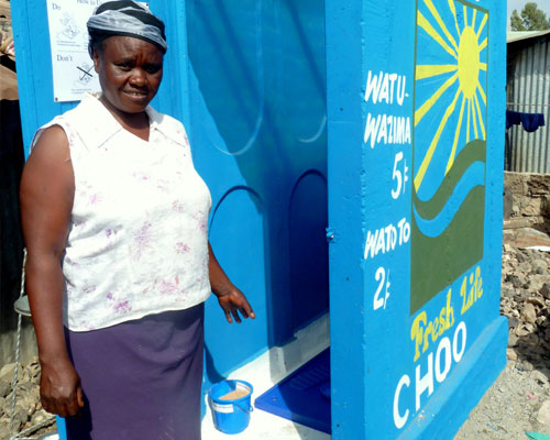 This woman runs one of Sanergy's sanitation centers and makes a profit by charging each customer a small fee. Customers can sign