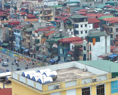 Water tanks by Sonha and other producers dot Hanoi's cityscape.