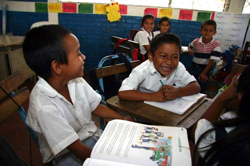 Kids in the EXCELENCIA schools are encouraged to work together. The smiling boy, center, was asked what he wanted to be when he