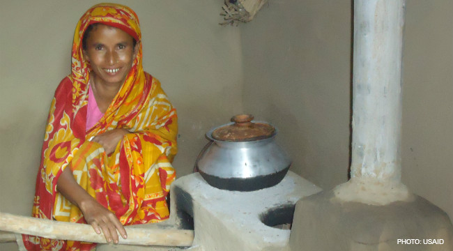 Image of woman in Bangladesh using modified clean cook stove