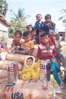 Cambodian refugees receive USAID-provided food assistance in the early 1990s.