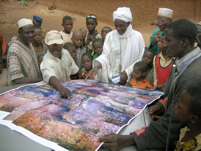 Community members review land maps