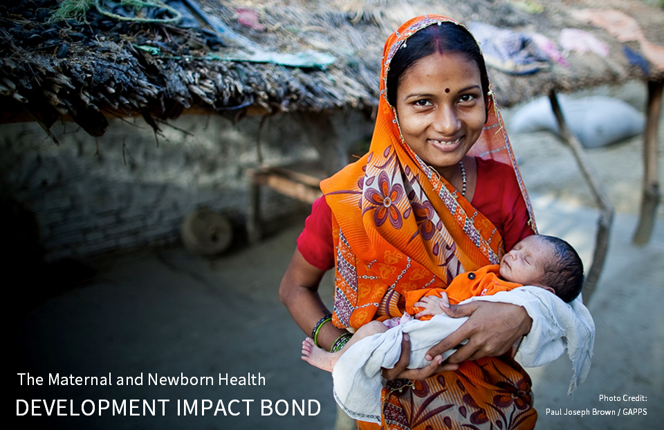 A smiling women from India holds her baby - Text Overlay: The Maternal and Newborn Health Development Impact Bond. Photo Credit: Paul Joseph Brown / GAPPS
