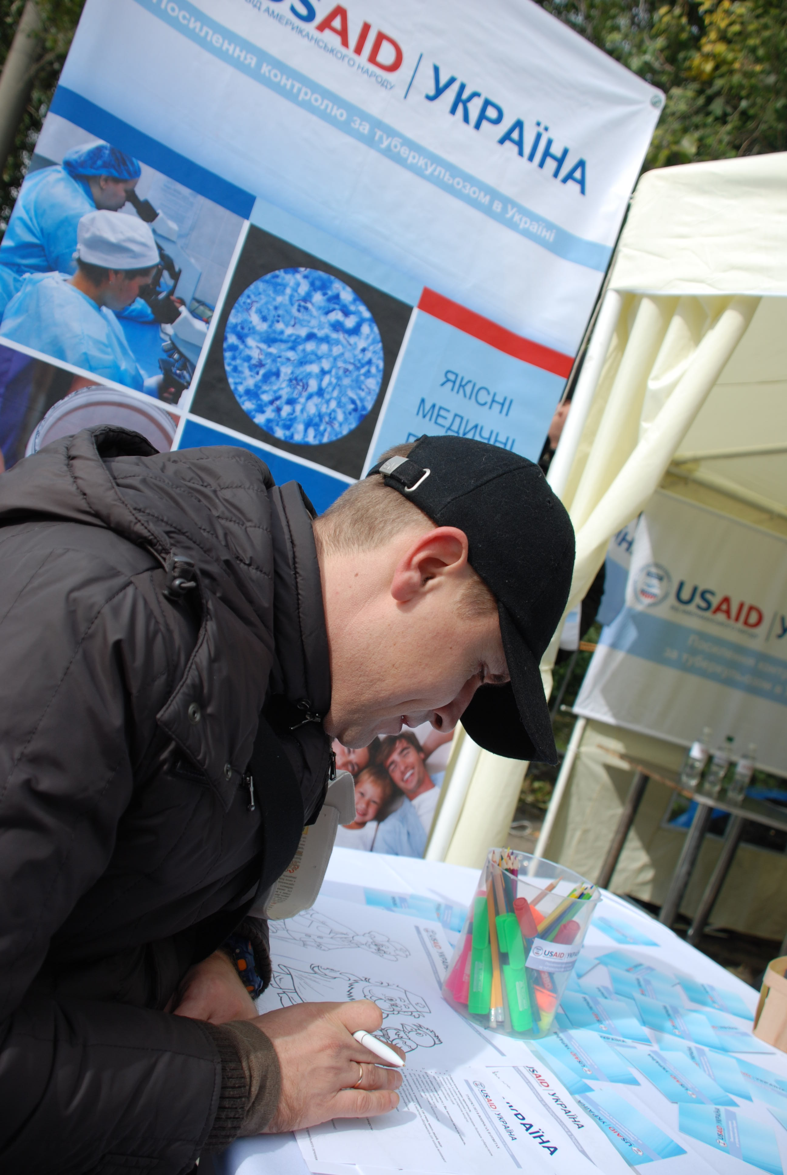 A visitor checks his knowledge of TB facts during a Mistechko USAID event.