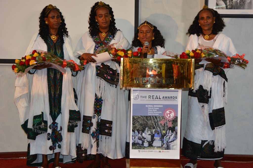 Teberih Tsegay gives remarks on behalf of four Ethiopian mothers who received the 2014 REAL Awards.