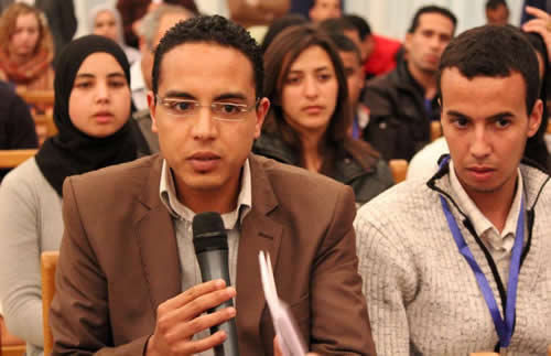 Image of two young Moroccan men speaking at a youth CSO coalition