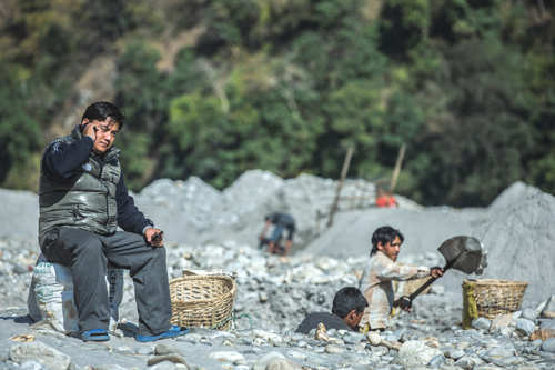 Umesh Sherchan, a stone quarry small entrepreneur in Kathmandu, uses mobile banking to pay the salary of his 40 employees and va