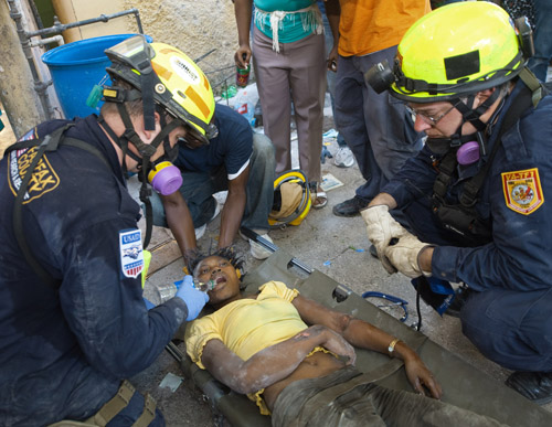 A student identified as Leoni gets her first drink of water in over 70 hours after being rescued from the rubble of the Universi