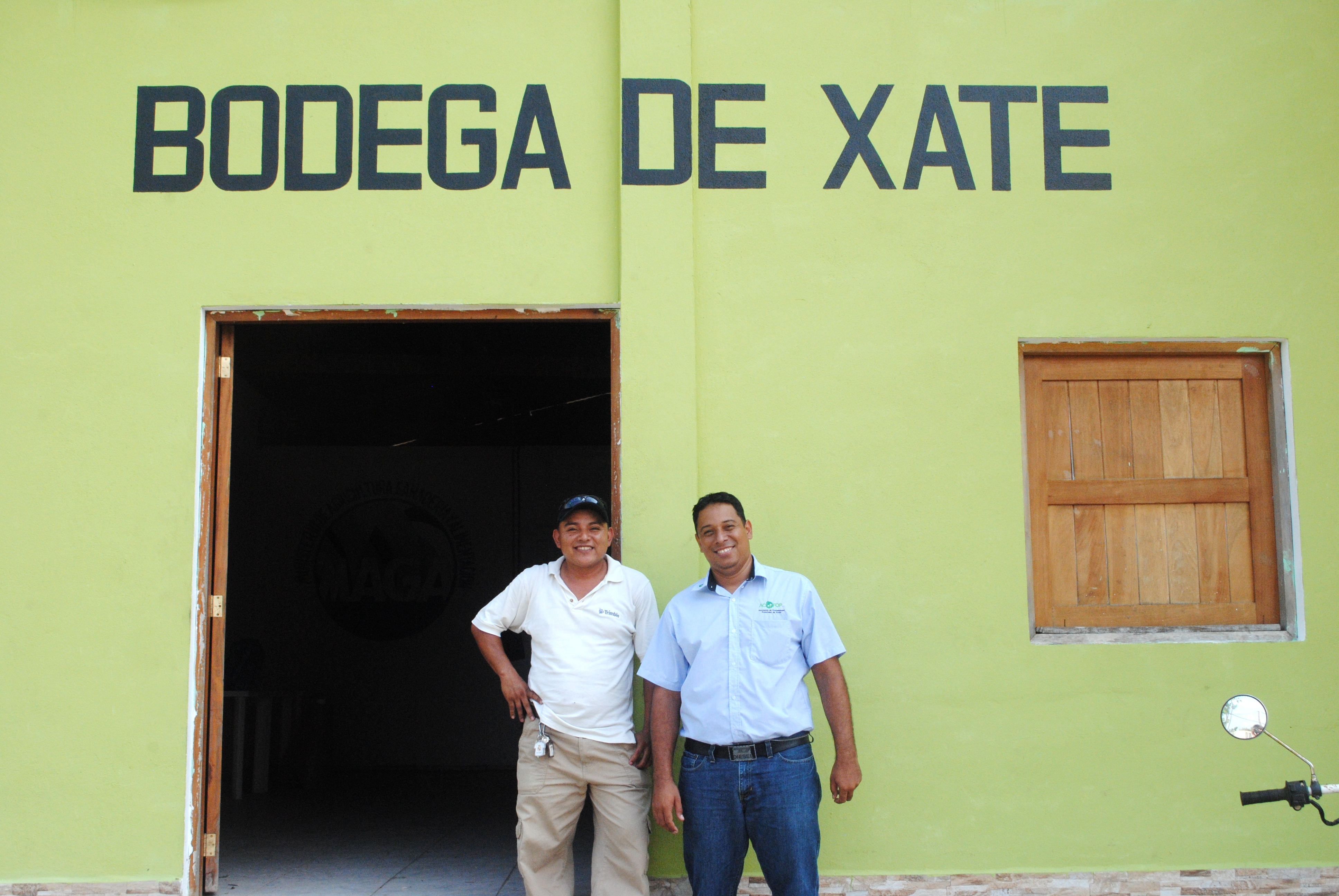 Melvin Barrientos, left, and Elmer Salazares of the Association of Forest Communities of Petén stand outside the xate bodega.