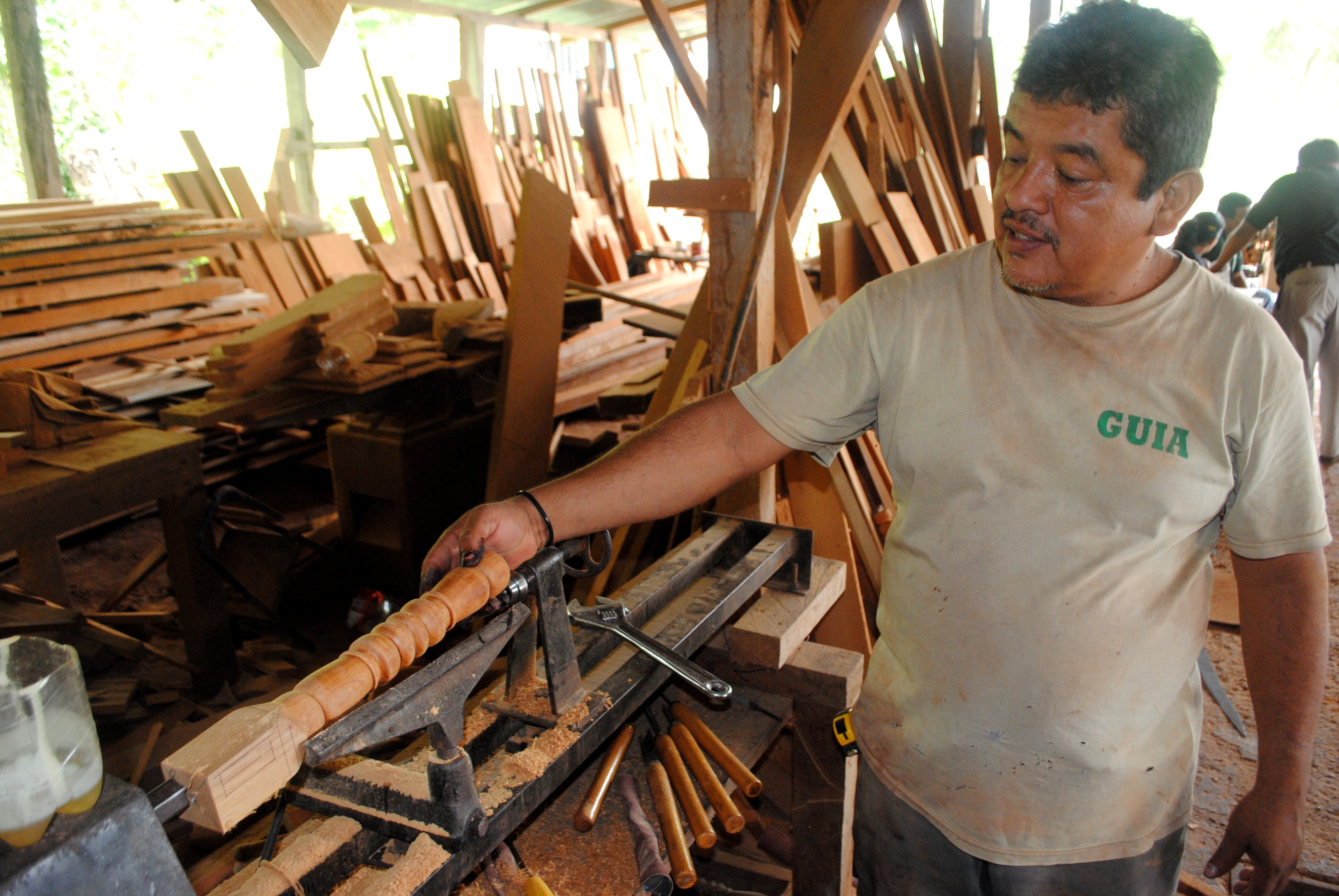 Rocaél Peña, a carpenter and woodworker in Uaxactún, demonstrates some of the new tools and techniques.