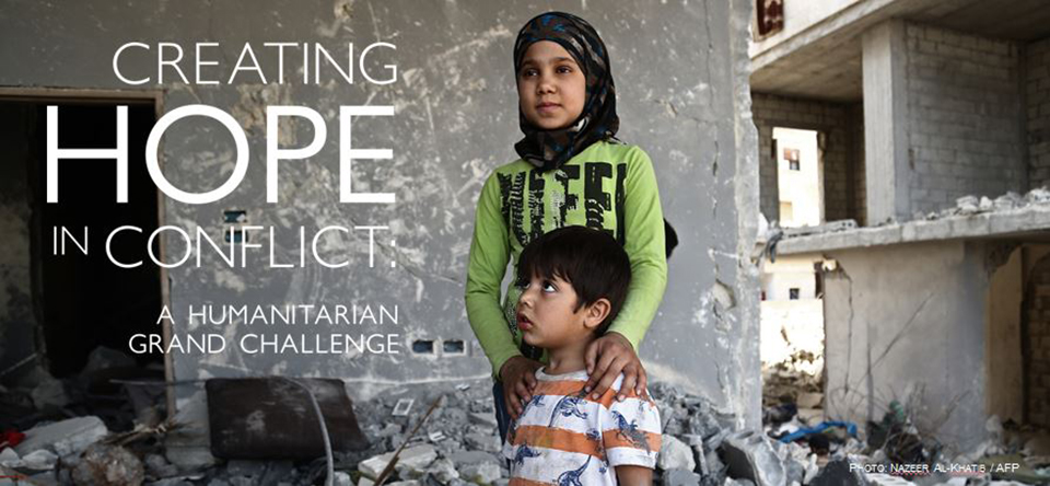 A Syrian girl and boy standing in rubble. Text reads: Creating Hope in Conflict: A Humanitarian Grand Challenge. Photo AFP