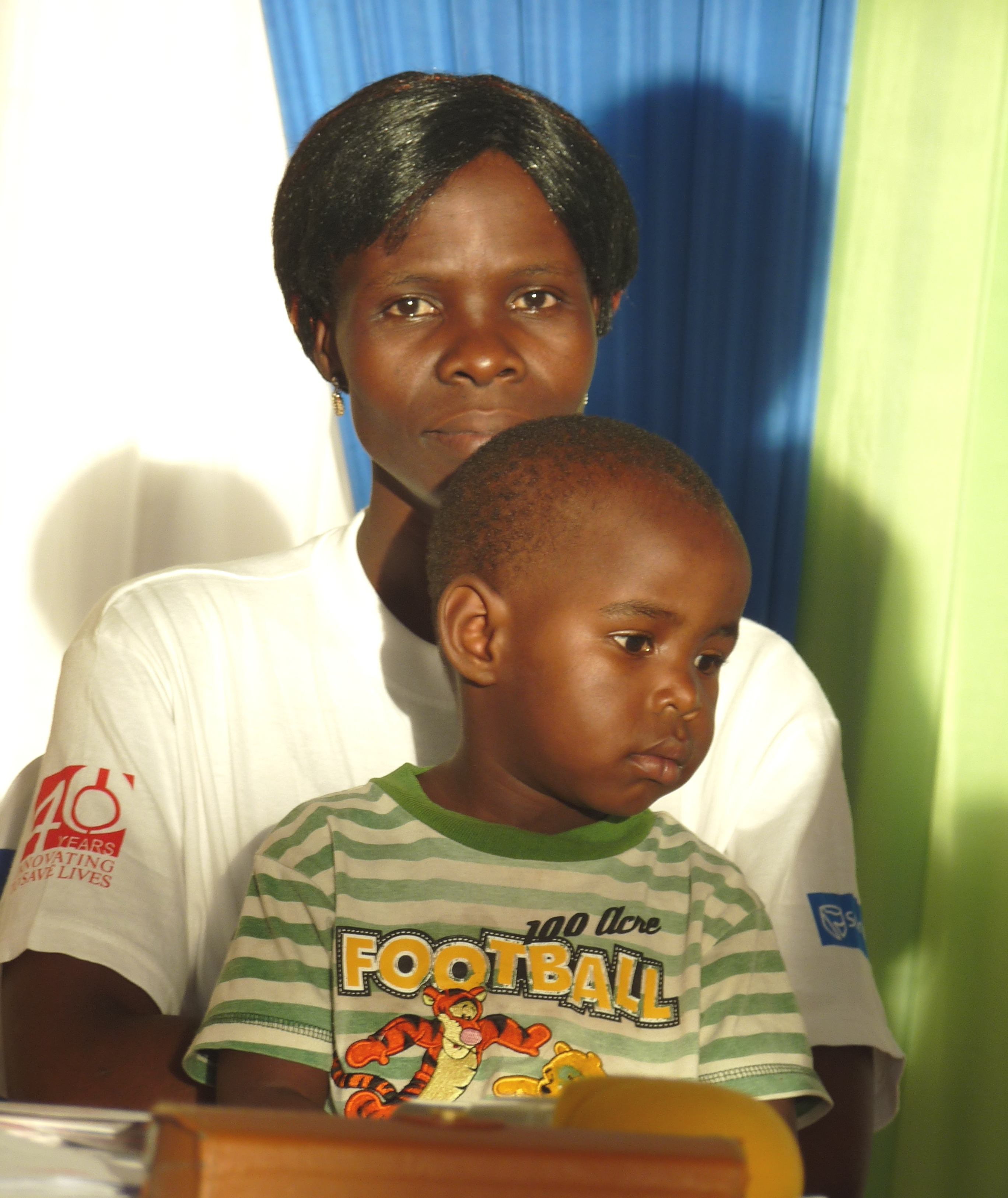 Milica Damiano with son, Chikondi, at Jhpiego's 40th anniversary celebration in Lilongwe, Malawi, March 2014