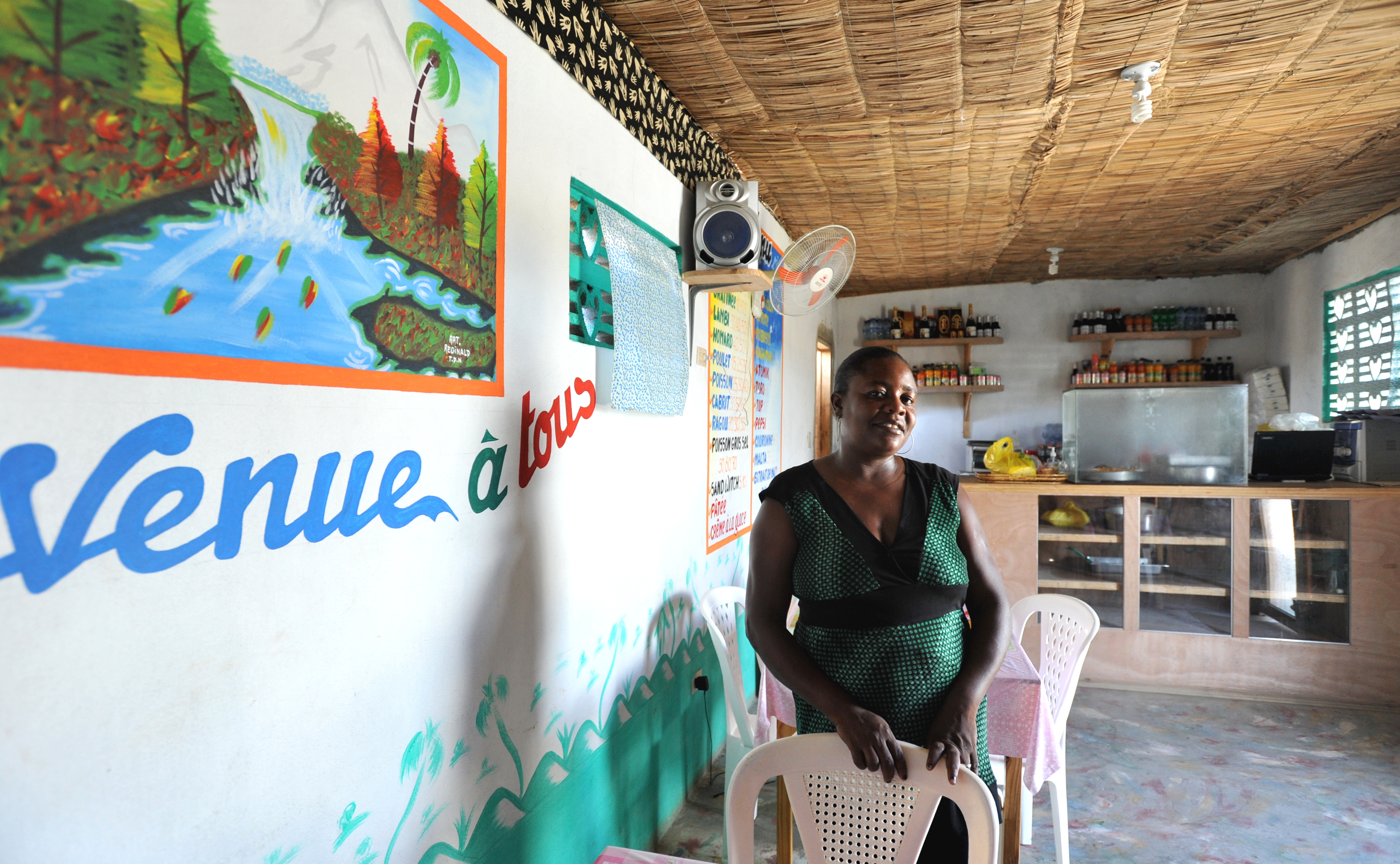 Achille Amiotte stands inside her restaurant in Caracol, Haiti, in May 2013.