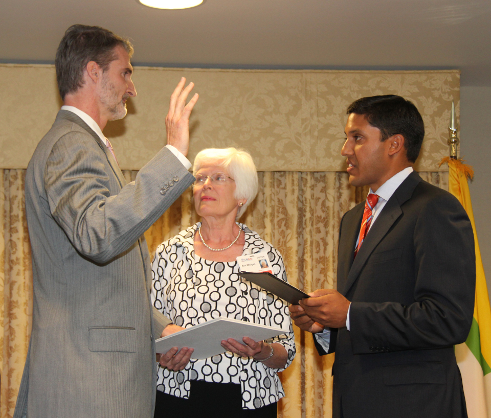 In 2012, USAID Administrator Dr. Rajiv Shah, right, administered the oath of office to Chris Milligan, the Agency's first Missio