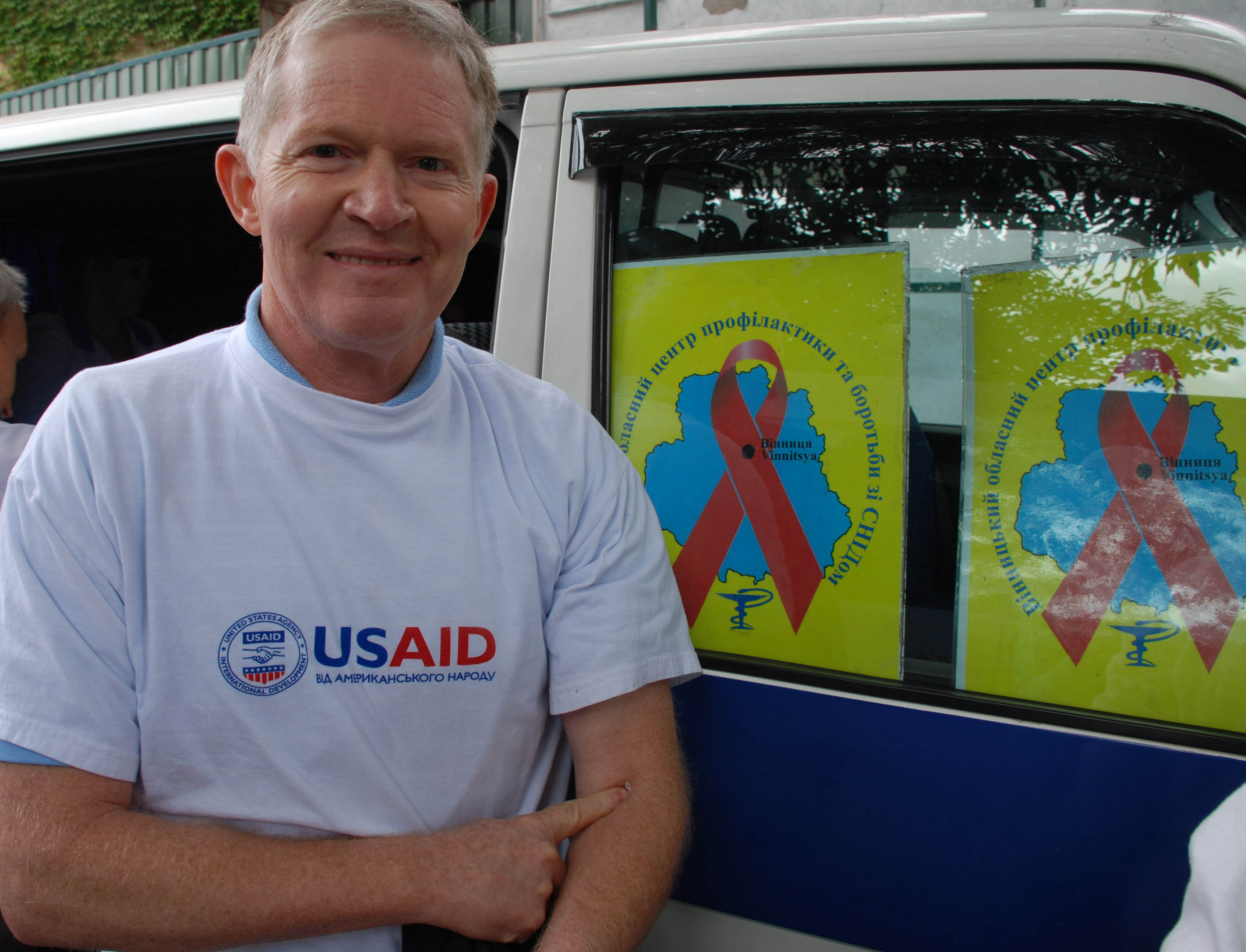 USAID Mission Director Jed Barton tests for HIV during a USAID field day event.