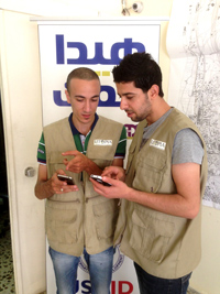 Youth volunteers test the mobile application launched by the Association for Development in Akkar and three partner NGOs in Trip