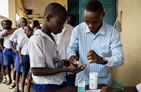 Thumbnail of a two young men distributing medicines for the May 2018 GH Newsletter.