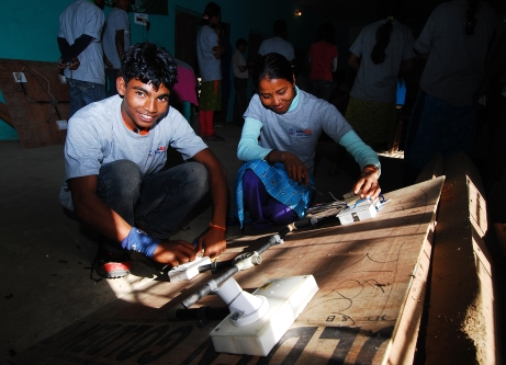 Image of two teenagers doing a hands-on electrician training in Dhangadi, Nepal