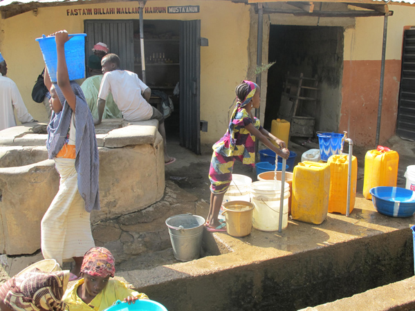 Bauchi town residents get water from a public standpipe.