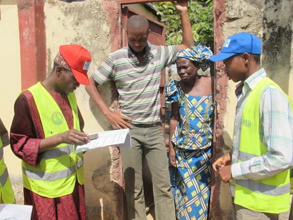 Surveyors interview a household about water usage. Part of reforming the utility involves a customer enumeration exercise that h