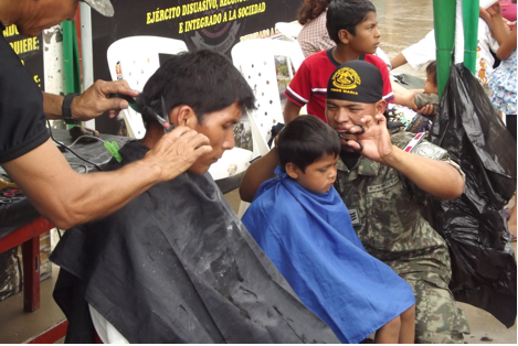 Peruvian Army commandos provide haircuts during the caravan held in held in Padre Abad province, March 23-24, 2013.