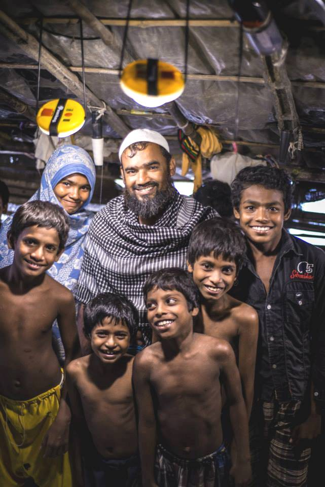 Asma Molla with her husband Jalal, their five sons, and their two solar lamps