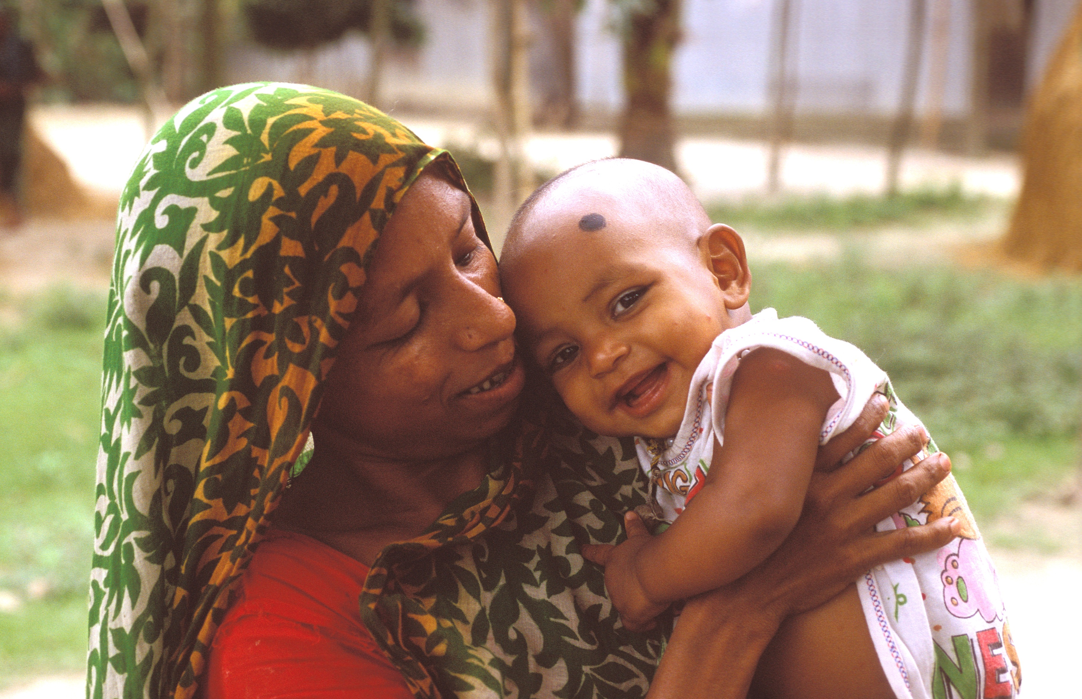 A woman  and child at a community nutrition center in Bangladesh