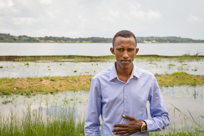 Photo of Francis Angumya in front of Lake Victoria.