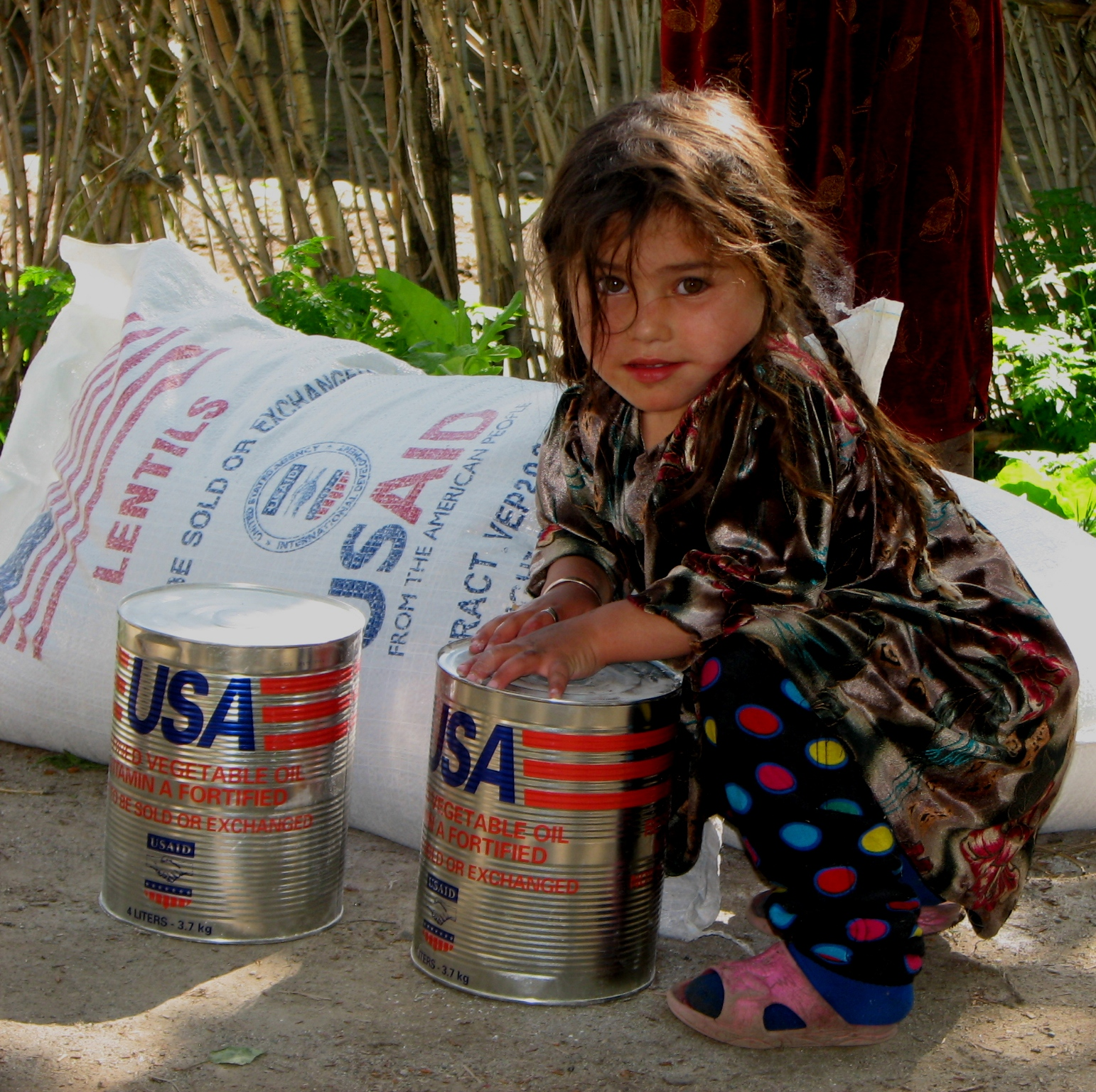 Families such as this one received  flour, lentils, and vegetable