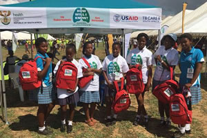South African girls show off their new World TB Day backpacks